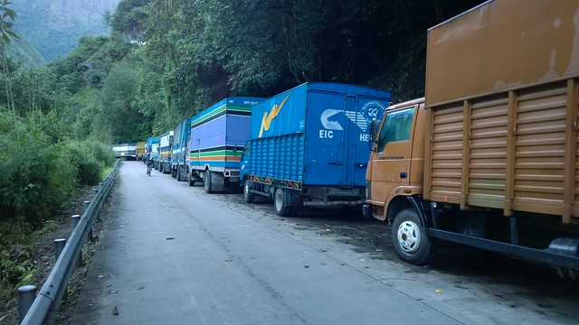 Parked trucks wait to cross the border, Zhangmu