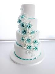 lavender(0.0), blue(0.0), wedding ceremony supply(1.0), cake(1.0), buttercream(1.0), aqua(1.0), turquoise(1.0), teal(1.0), food(1.0), cake decorating(1.0), icing(1.0), wedding cake(1.0),