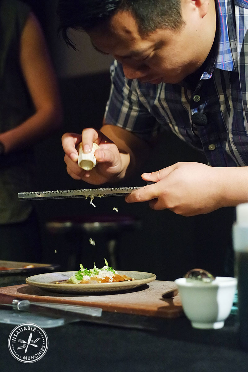 Brendan Fong from Mr Wong grates horseradish over slices of soy marinated hiramasa kingfish
