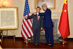 U.S. Secretary of State John Kerry shares the historical significance of collection items with Chinese Foreign Minister Wang Yi in the John Quincy Adams State Drawing Room at the U.S. Department of State in Washington, D.C., on October 1, 2014. [State Department photo/ Public Domain]