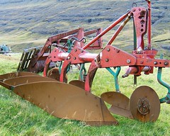 vehicle(0.0), construction equipment(0.0), agriculture(1.0), field(1.0), plough(1.0), agricultural machinery(1.0), land vehicle(1.0), harvester(1.0),