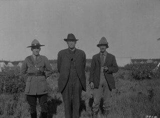 Inspector Bruce, Royal Canadian Mounted Police (RCMP); Conroy, Indian Commissioner; and Hugh Pearson, DLS; Fort Providence, Northwest Territories / Inspecteur Bruce, Gendarmerie royale du Canada; Conroy, commissaire des Indiens; et Hugh Pearson, arpe