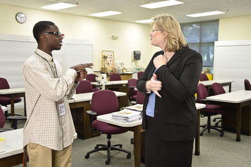 APHIS Work-to-Learn Student Carroll Barnes and USDA Federal Disability Employment Program Manager Alison Levy converse about his work with the APHIS Professional Development Center in Frederick.