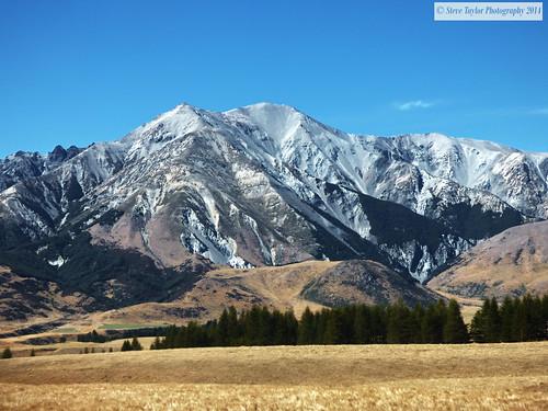 blue newzealand sky brown sun white mountain alps up rock sunny canterbury southern nz southisland