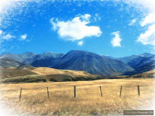 blue newzealand sky cloud brown sun mountain art field sunshine yellow digital fence landscape hill sunny canterbury nz southisland wonky southernalps