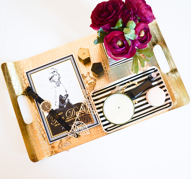 DIY HOME DECOR: use black and white striped paper bag and vase for flowers (ranunculus), with gold and glam tray from Target, white and black striped jewelry tray by J. crew, & The dress book by Megan Hess