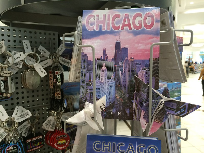 A Chicago postcard folded into an origami butterfly