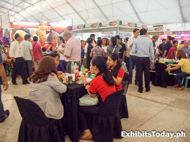 People enjoying foods at the marketplace