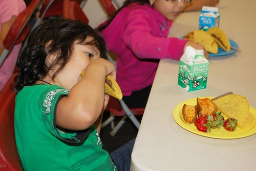 A student from DC Bilingual Public Charter School enjoys a taco.