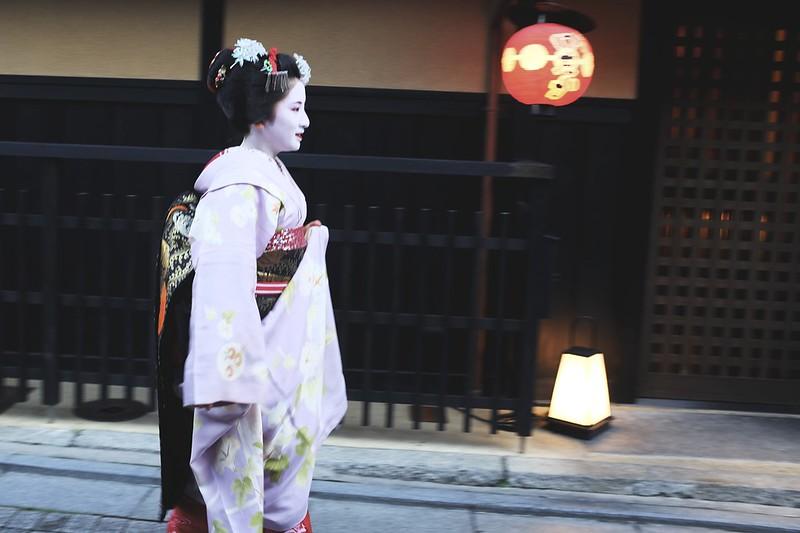 Maiko in purple kimono.