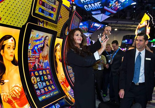 Lynda Carter takes a Selfie in front of the Wonder Woman a lot machines during the Global Gaming Expo at the Sands Expo in Las Vegas Sept 30, 2014.