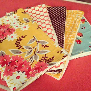 A stack of fall-inspired burp cloths a la @stitchedincolor