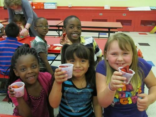 Dunbar Elementary School students enjoying fresh, local strawberries during Delaware's Strawberry week.