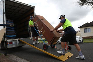 Loading large boxes up the ramp onto removal truck photo | by sunset_removals