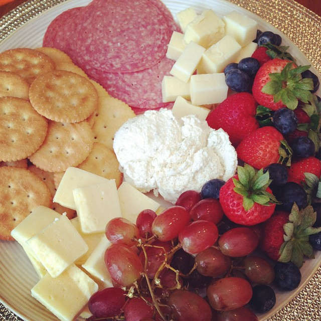 We are having a family picnic outside for dinner tonight. I just finished the cheese, salami, crackers and fruit plate... Brownies are in the oven... And, I still need to prep the dollar roll sandwiches! After our picnic on this 80 degree day, we are goin