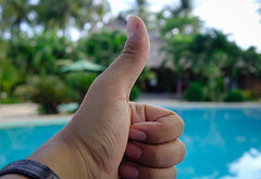 Asian man hand showing thumbs up