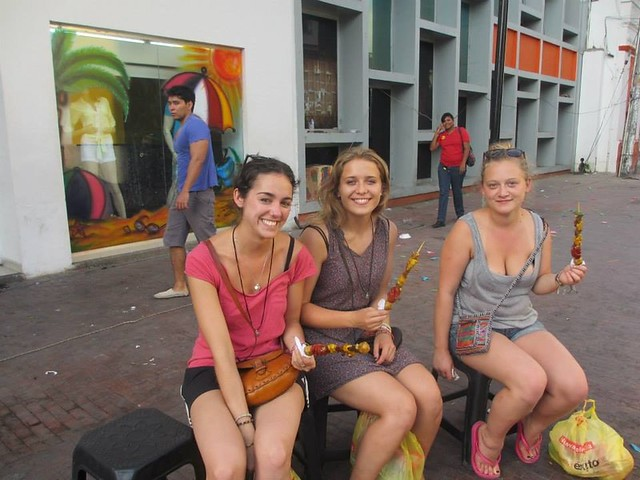 Three girls with street food in Santa Marta, Colombia