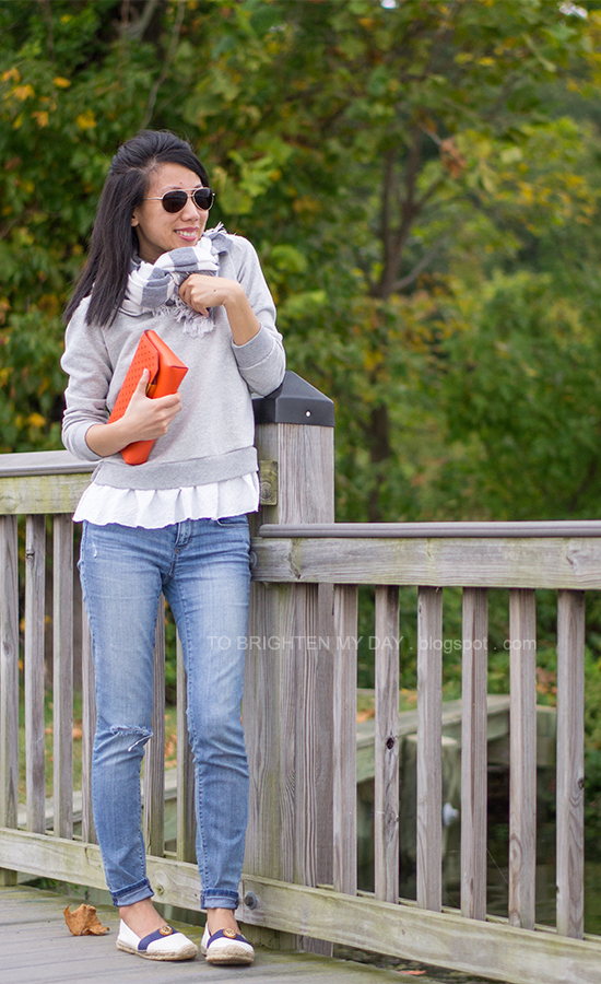 rugby striped scarf, gray ruffled sweatshirt, orange clutch, espadrilles