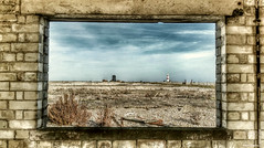 A view of the black beacon and lighthouse, Orford Ness