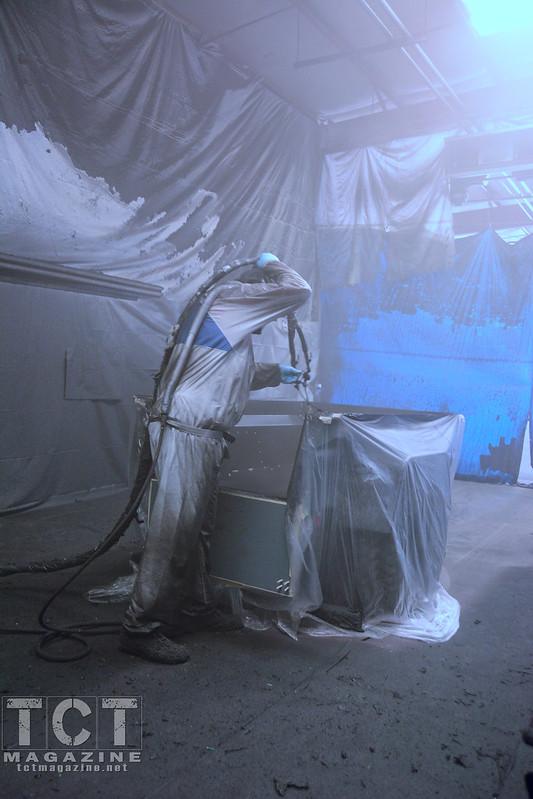 spraying Rhino Lining in a trailer
