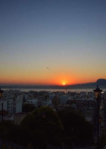 road trees sunset mountains cars greece lamppost patras patra πατρα ηλιοβασιλεμα αγιουνικολαου