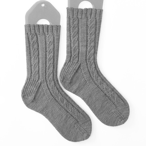 A black and white photo of @littlecreatable's socks!!! Pattern is Faux Cables by Jen Lucas. Just need to find some treats to send with and then it will be mailed, Brie!!! It's killing me that I can't share the color!!!! Pair 18/20 #socksforfriends
