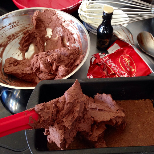 Spreading double chocolate mix onto biscuit base. Cheesecake. Food.