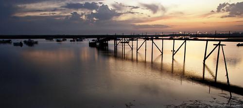 sunset sky cloud lake portugal water architecture landscape faro boats golden pier seaside outdoor shore copyspace algarve waterscape riverscape julioc j5074