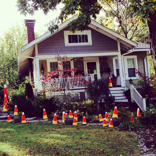 If you know me, you know I am candy corn crushing this fall. I just made the hubs turn around so I could take a pic of this house. OMG, traffic cone corn!!!! LOVE #webstergroves