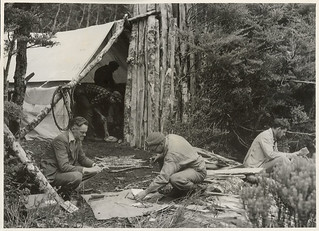 Members of the Notornis Expedition examining Moa bones at the party's camp, Te Anau