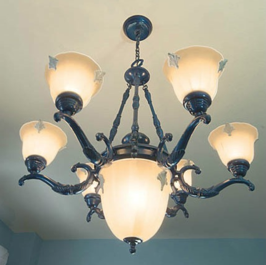 Blue metallic refinishing a chandelier for home office