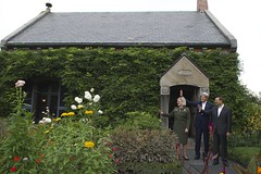 U.S. Secretary of State John Kerry, Chinese State Councilor Yang Jiechi, and National Park Service Deputy Superintendent Caroline Keinath wave to tourists as they leave the Stone Library during a tour of the Adams National Historical Site in Quincy, Massachusetts, following a series of bilateral meetings in the Secretary's hometown of Boston on October 18, 2014. [State Department photo/ Public Domain]