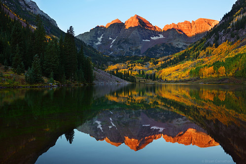 Putting Gold: Maroon Bells Peaks Reflecting in Maroon Lake