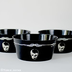 Cream skull printed black bowls