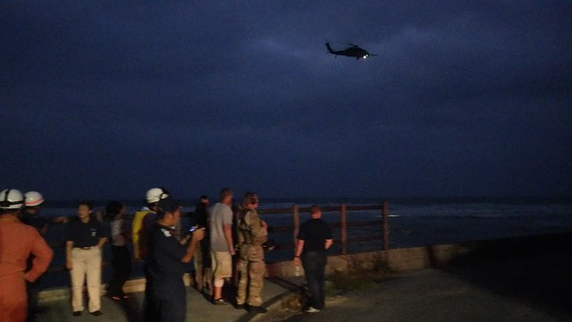 RESCUE HELICOPTER CASTS A SPOTLIGHT ON THE SURF -- SOUTH SIDE OF YONA POINT (10-sec Video)
