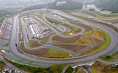 highway(0.0), lane(0.0), residential area(0.0), overpass(0.0), sport venue(1.0), junction(1.0), bird's-eye view(1.0), road(1.0), controlled-access highway(1.0), aerial photography(1.0), race track(1.0), infrastructure(1.0), intersection(1.0),