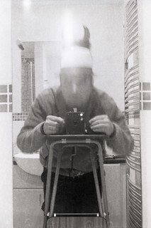 reflected self-portrait with Brownie No.2 camera and horned hat