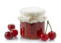 jar of fruit jam with cherries