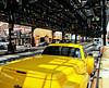 Yellow car under the el
