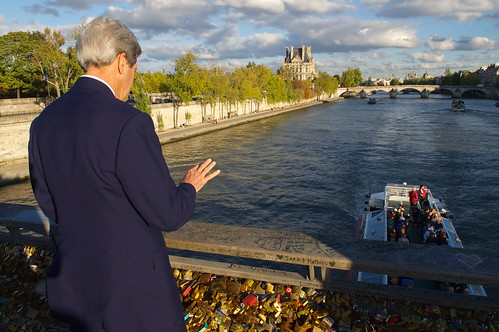 Secretary Kerry Waves to Boaters on Seine River During Walk to French Foreign Ministry in Paris