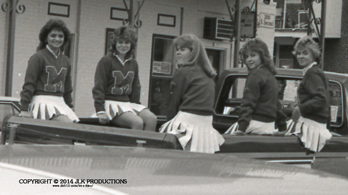 Tri-X Files 84_27.09a: Model High School Girls Varsity Cheerleaders in the Madison High School Homecoming Parade, on South 2nd Street