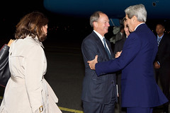 U.S. Ambassador to Germany John Emerson welcomes U.S. Secretary of State John Kerry as he arrives in Berlin on Oct. 21, 2014, for meetings with German Chancellor Angela Merkel and German Foreign Minister Frank-Walter Steinmeier. [State Department photo/ Public Domain]