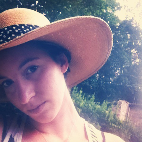 Image of Emily Sandall wearing a wide brimmed sun hat.