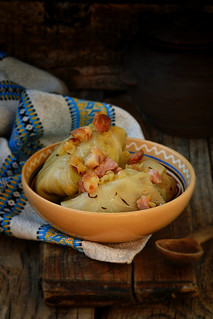 cabbage rolls  with fried bacon and onion