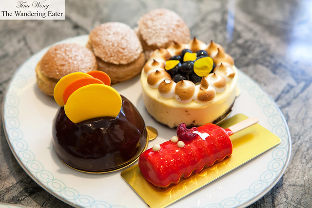 Chocolate dome cake, raspberry popscicle cake, blueberry cheesecake, and choux pastry Four Season's Patisserie