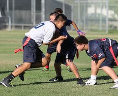 american football(0.0), football(0.0), gridiron football(0.0), football player(1.0), sports(1.0), rugby football(1.0), competition event(1.0), team sport(1.0), tackle(1.0), player(1.0), training(1.0), tournament(1.0), team(1.0),