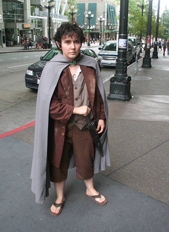 a hobbit standing on the street in seattle