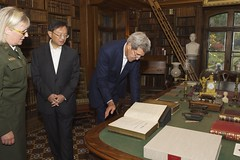 U.S. Secretary of State John Kerry looks at the Mendi Bible as he and Chinese State Councilor Yang are led by National Park Service Deputy Superintendent Caroline Keinath on a tour of the Adams National Historic Site in Quincy, Massachusetts, following a series of bilateral meetings in the Secretary's hometown of Boston on October 18, 2014. [State Department photo/ Public Domain]