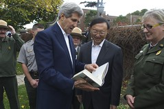 U.S. Secretary of State John Kerry presents Chinese State Councilor Yang Jiechi with an autographed copy of the John Adams biography by historian David McCullough after a tour of the Adams National Historic Site in Quincy, Massachusetts, following a series of bilateral meetings in the Secretary's hometown of Boston on October 18, 2014. [State Department photo/ Public Domain]