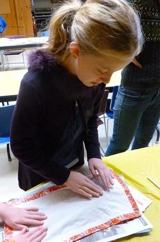 a child creates a fish print